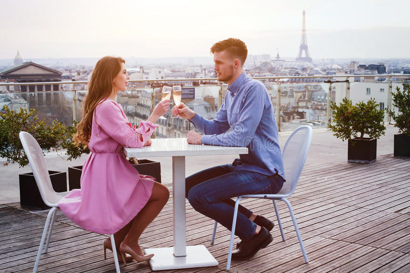 Couple drinking champagne in luxury restaurant royalty free stock photo