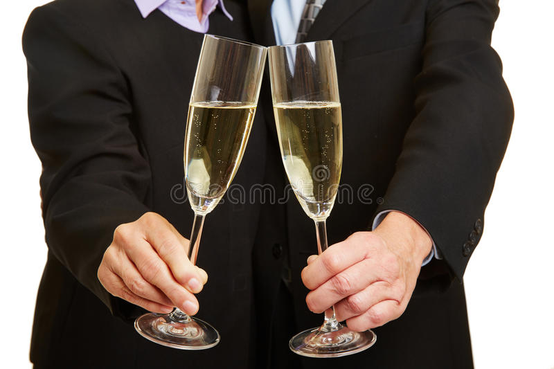 Couple drinking champagne for New Year's Eve stock photo