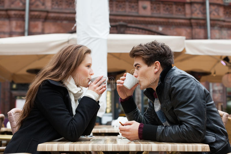 Couple Drinking Coffee Outdoor Restaurant stock photography