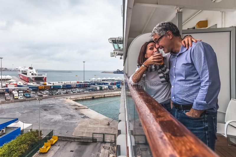 Couple drinking a drink on the deck of a cruise ship stock photography