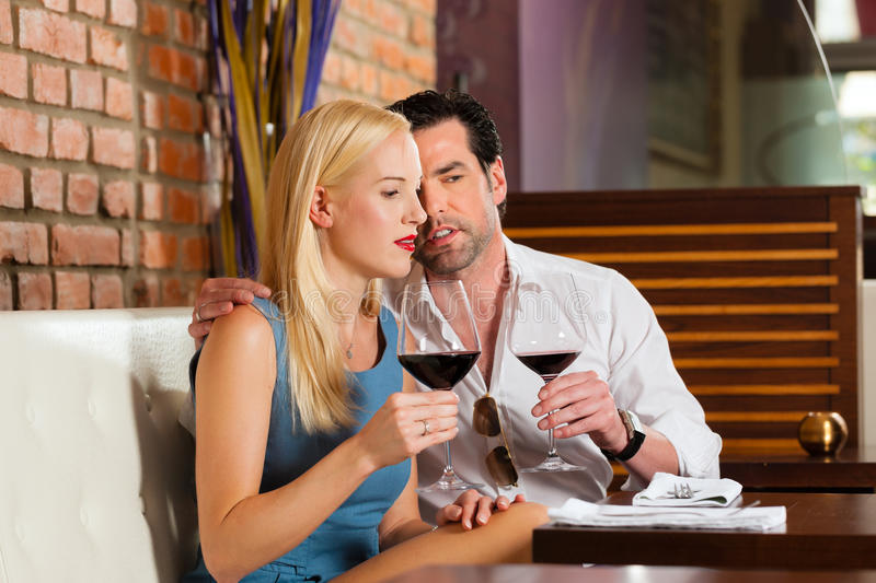 Download Couple Drinking Red Wine In Restaurant Stock Image - Image: 26487043