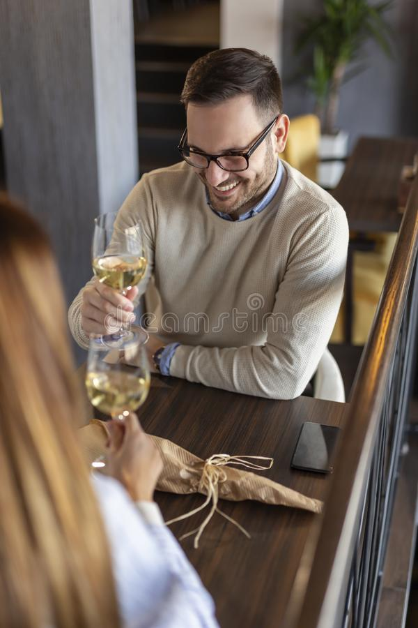 Couple drinking wine and making a toast royalty free stock photo