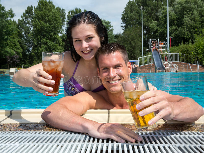 Download Couple With Drinks In The Sund At Pool Stock Photo - Image: 33431340