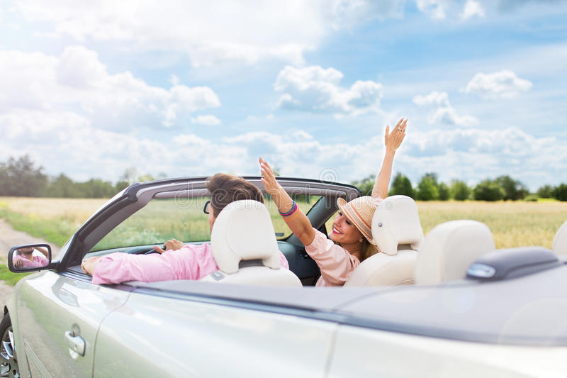 Couple Driving in Convertible stock images