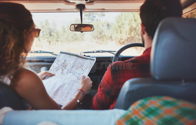 Couple driving on country road royalty free stock photography