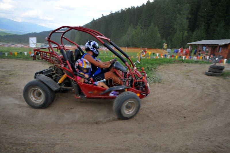 Couple driving Dune Buggy stock photo
