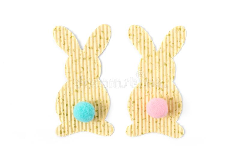 Couple of easter bunny textured paper decorations ornament isolated on white, top view. Free copy space. stock photography