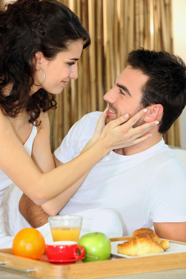 Couple eating breakfast in bed. At the weekend stock photo