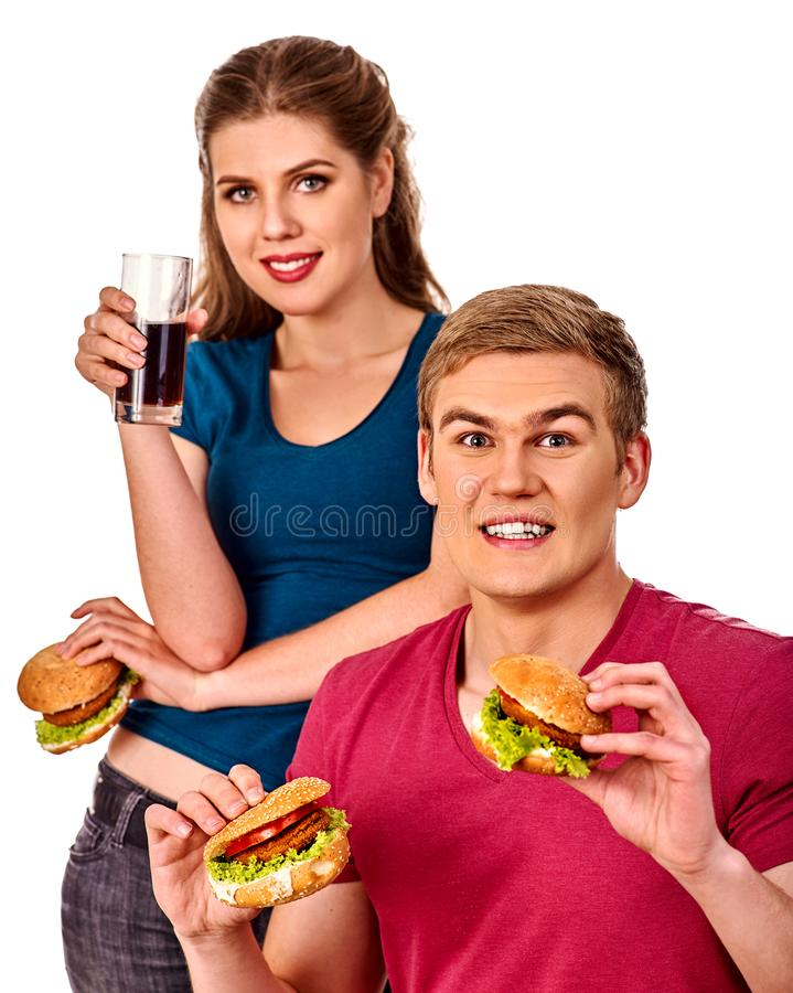 Couple eating fast food. Man and woman treat hamburger . royalty free stock photography