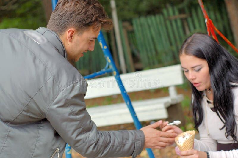 Couple eating ice cream stock image