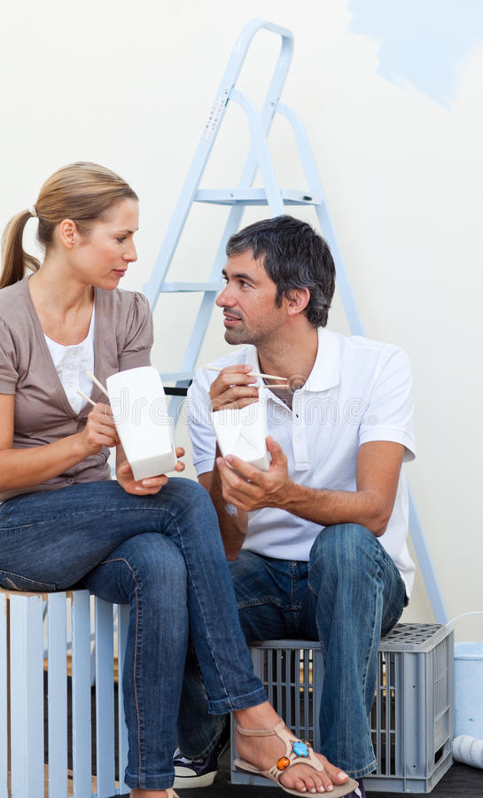 Download Couple Eating While Renovating Their New House Stock Image - Image: 12191003