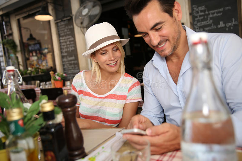 Couple eating at restaurant in Rome royalty free stock photo