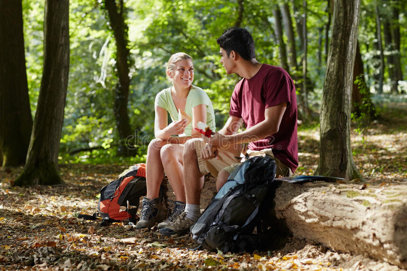 Couple eating snack after trekking stock photos