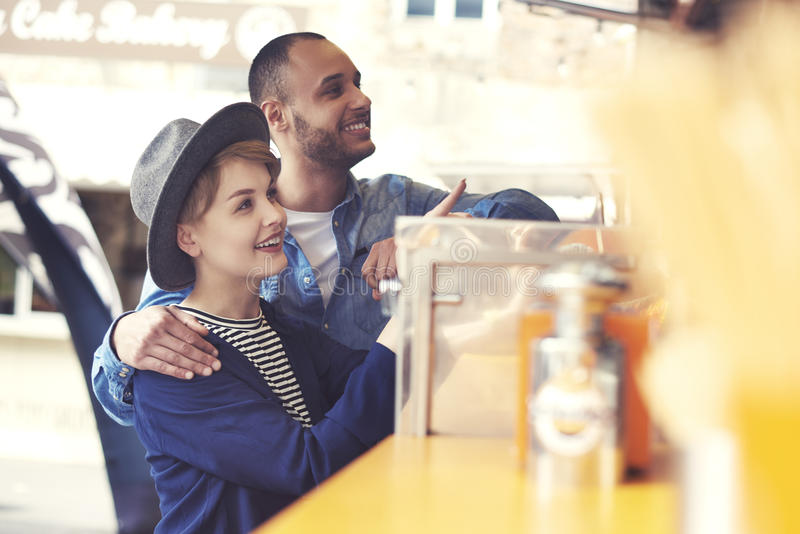 Couple during the eating street food stock images