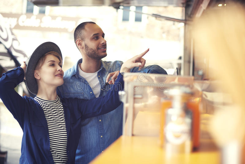 Couple during the eating street food stock photography