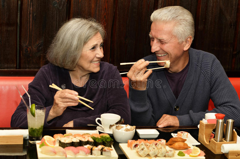 Couple eating sushi royalty free stock photography