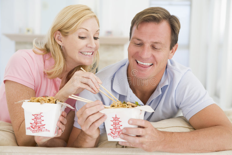 Couple Eating Takeaway meal, mealtime Together royalty free stock images