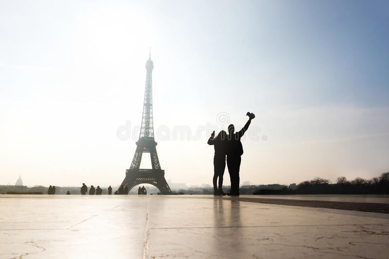Couple at Eiffel Tower. Travelers and tourists. stock photos