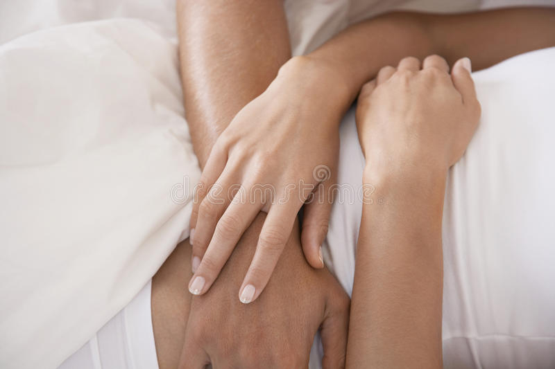 Couple Embracing In Bed stock images