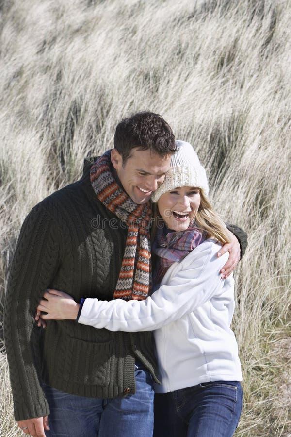 Couple Embracing In Long Grass stock photos