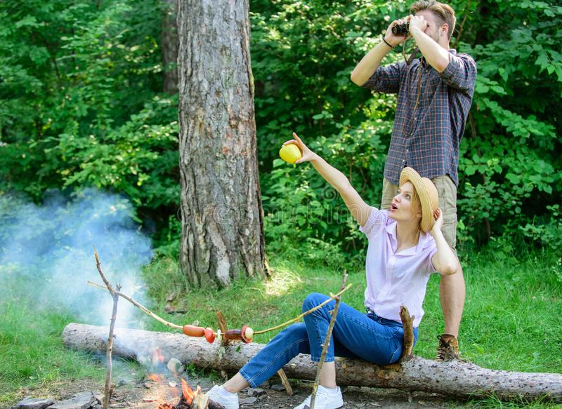 Couple enjoy hike in forest observing nature. Couple ornithologists expedition in forest. Observing nature concept royalty free stock photo