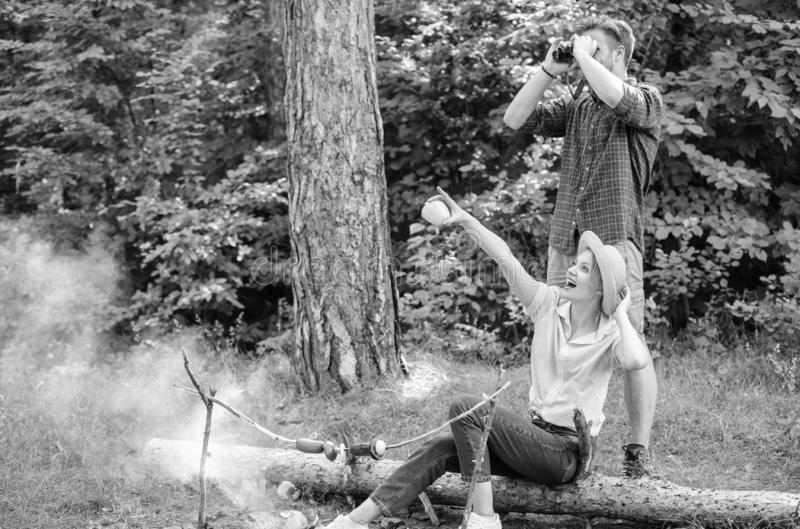 Couple enjoy hike in forest observing nature. Couple ornithologists expedition in forest. Woman and man looking stock image