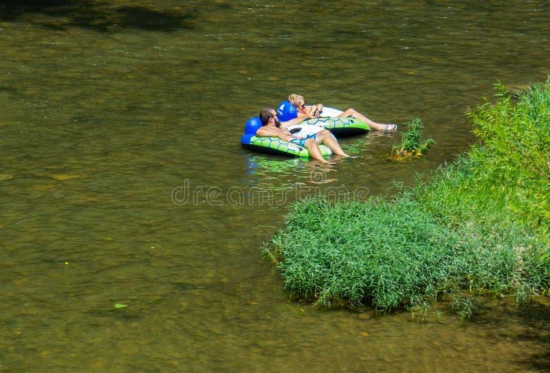 Couple Enjoy a Summer Day on the Roanoke River. Roanoke, VA, August 4th: Couple enjoying tubing on a hot summer's day on the Roanoke River located in royalty free stock photos