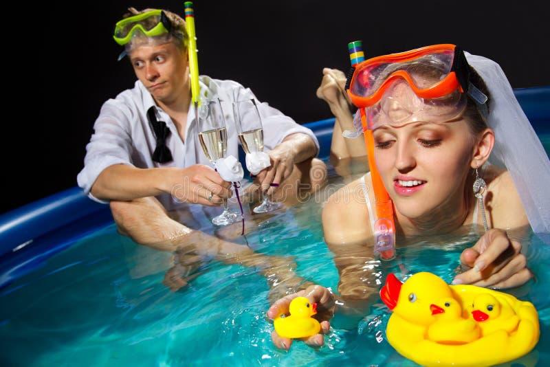Couple is enjoyin in pool stock photography