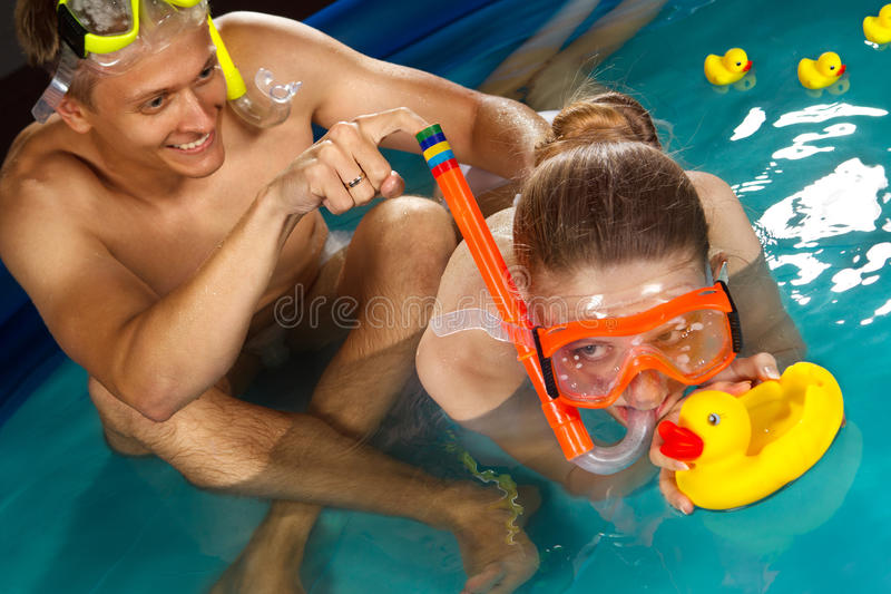 Couple is enjoyin in pool stock photo