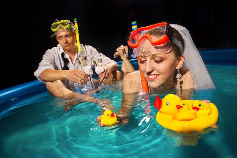 Couple is enjoyin in pool royalty free stock photo