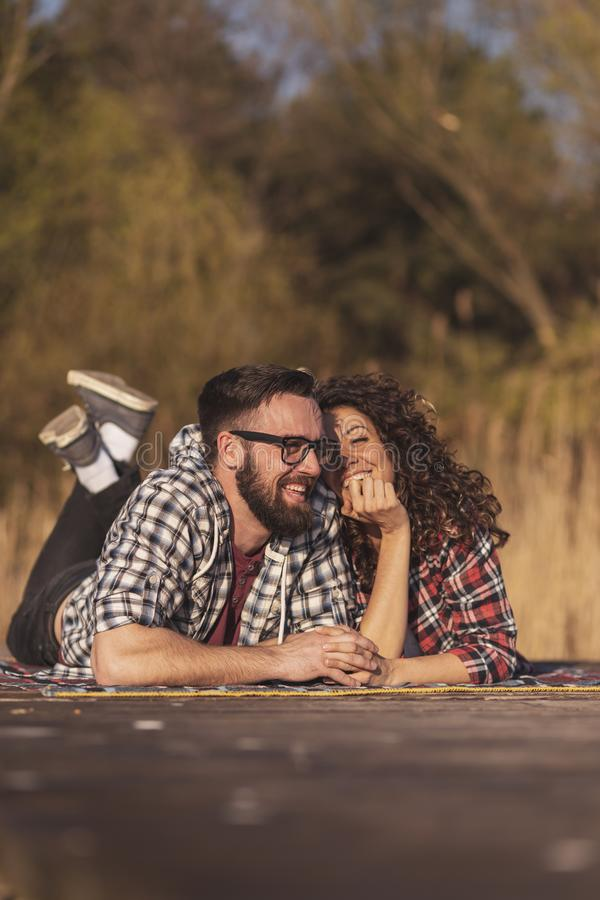 Couple enjoying autumn day outdoors royalty free stock photography