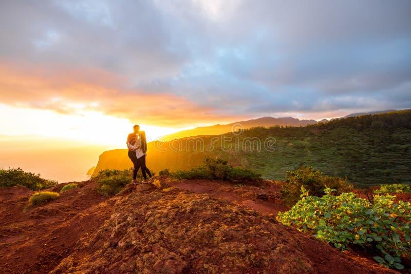 Couple enjoying beautiful sunrise. Beautiful landscape view with couple standing together near mirador de Abrante on La Gomera island on the sunrise stock photo