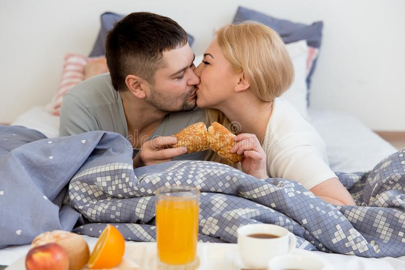 Couple enjoying breakfast in bed. In the morning stock photos