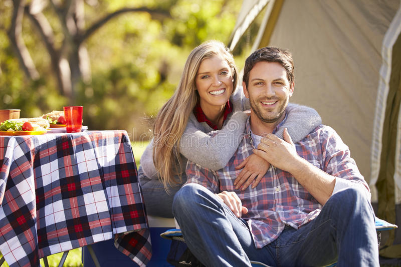 Couple Enjoying Camping Holiday In Countryside. Smiling stock image