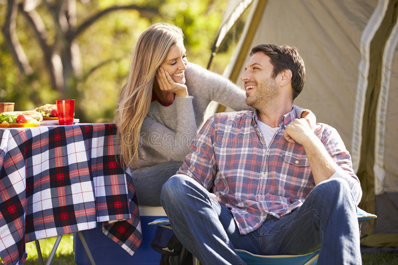 Couple Enjoying Camping Holiday In Countryside. Smiling stock photos