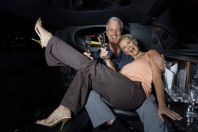Couple Enjoying Champagne In Limousine