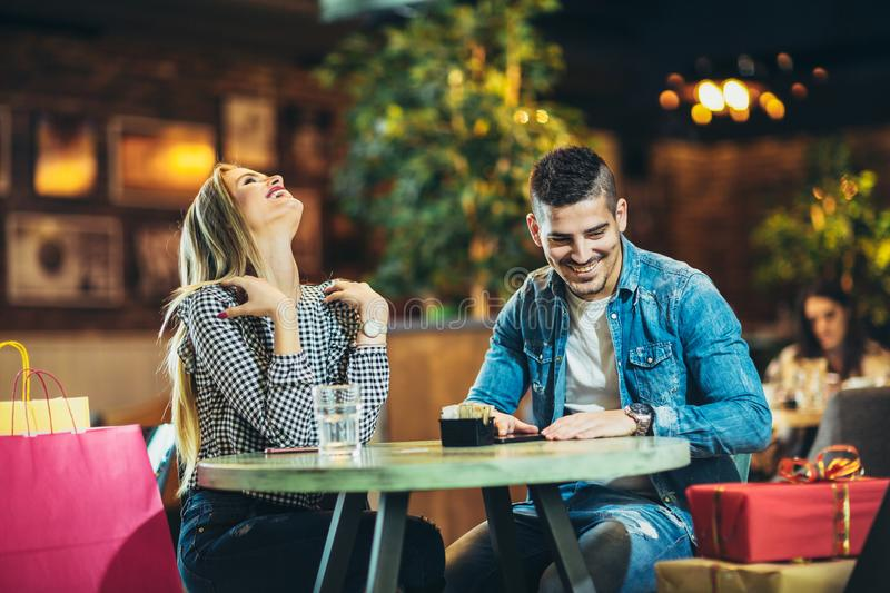 Couple enjoying the coffee shop after Christmas shopping royalty free stock photos