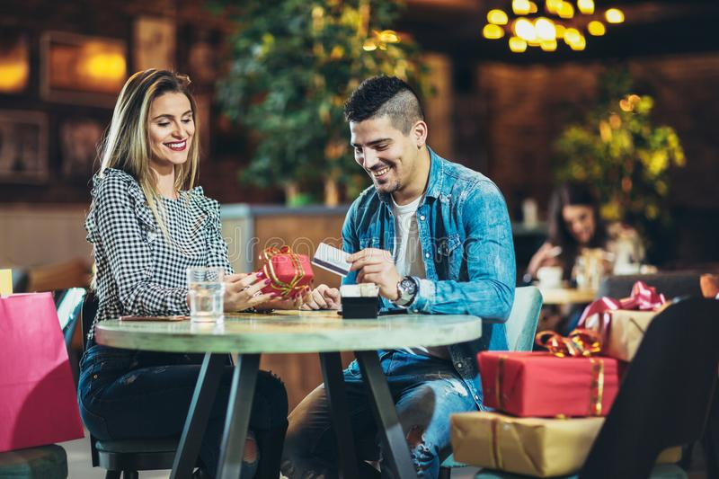 Couple enjoying the coffee shop after Christmas shopping royalty free stock photo
