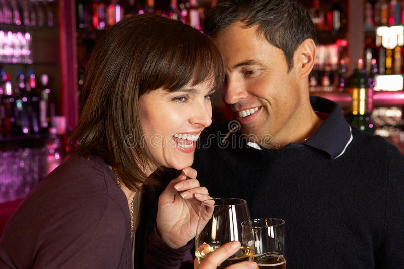Download Couple Enjoying Drink Together In Bar Stock Image - Image of evening, adult: 24385107