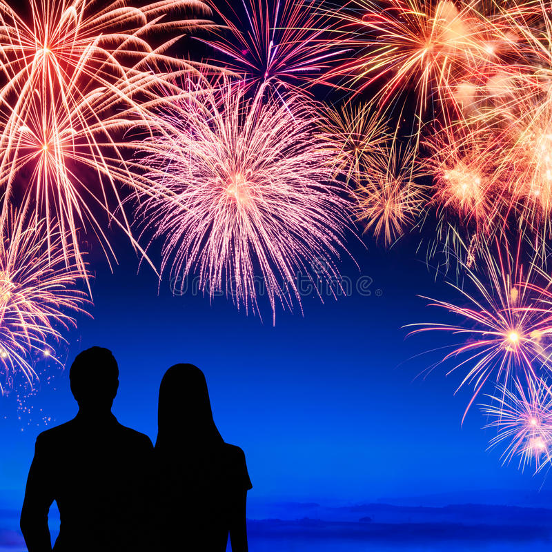 Couple enjoying a fireworks display stock illustration