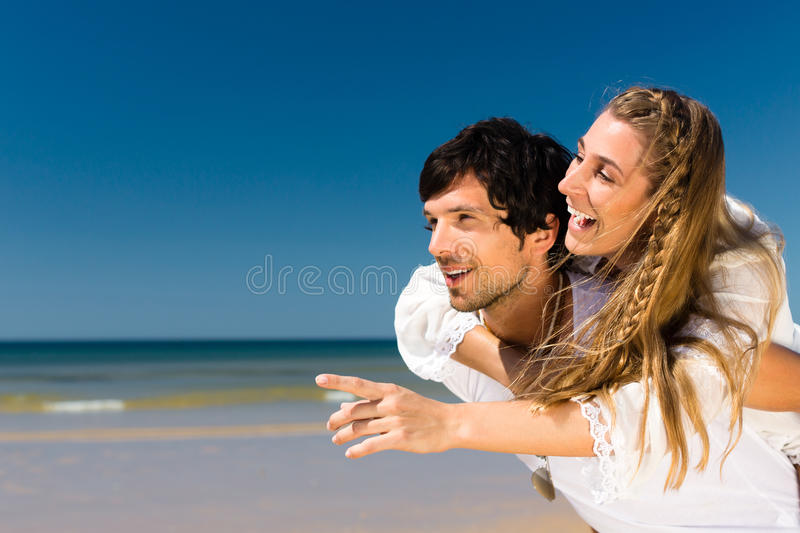 Download Couple Enjoying Freedom On The Beach Stock Photo - Image: 29150838