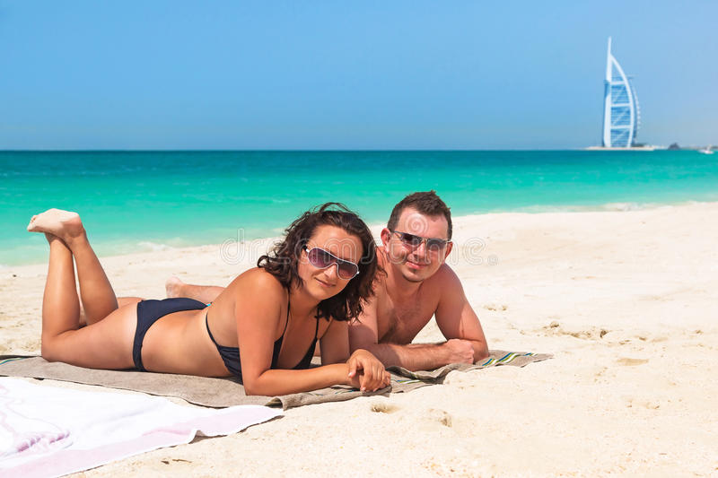 Couple Enjoying Holidays On The Beach Stock Photo