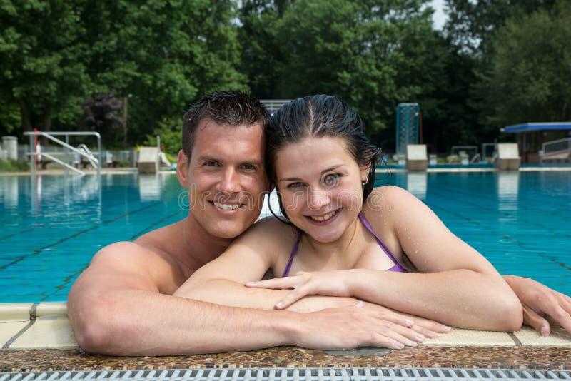 Download Couple Enjoying Holidays At Pool Edge Stock Photo - Image: 33431288