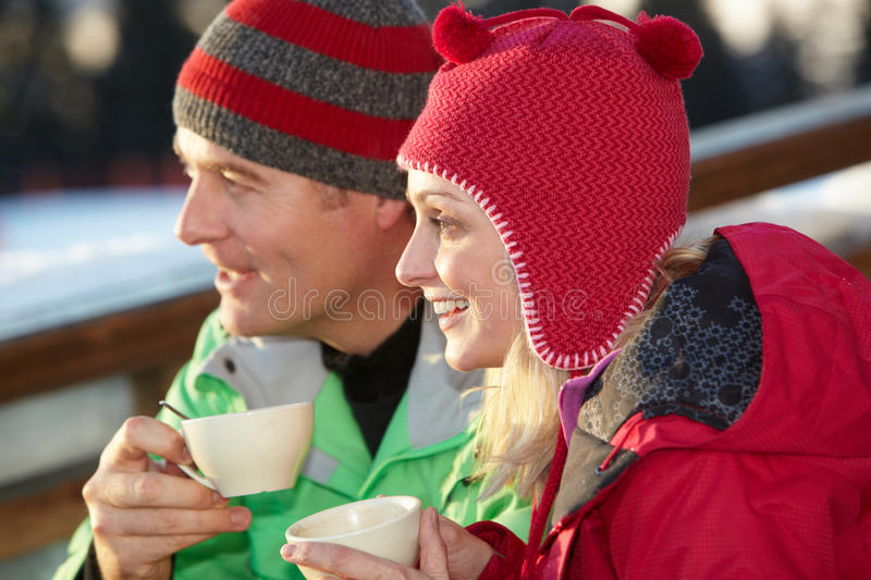 Download Couple Enjoying Hot Drink In Cafe At Ski Resort Stock Photo - Image of outside, smiling: 24477142