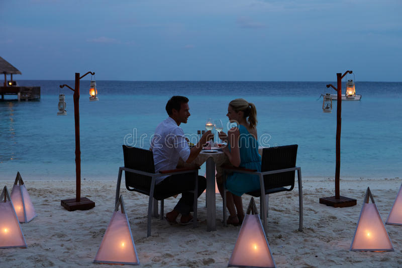 Couple Enjoying Late Meal In Outdoor Restaurant Stock Image