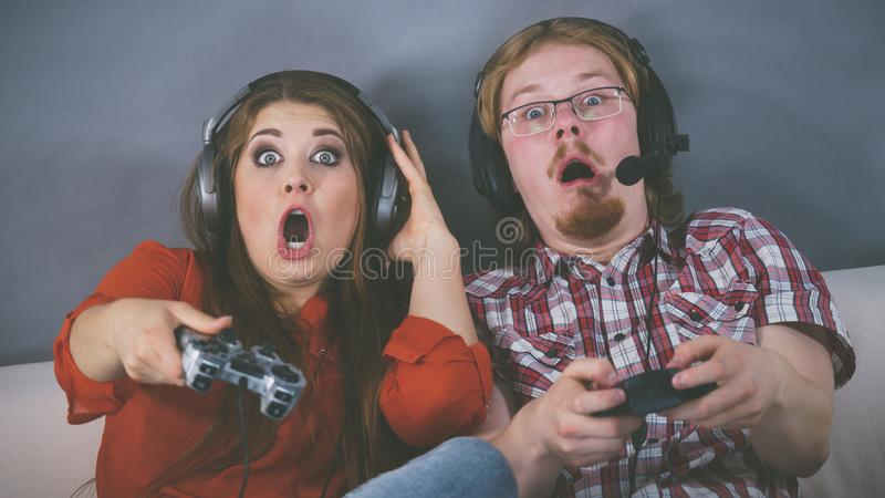 Gamer couple playing games stock photos