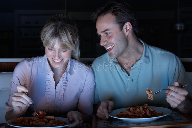 Download Couple Enjoying Meal Whilst Watching TV Stock Image - Image of evening, food: 18746135