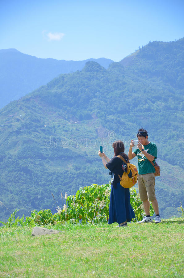 Couple enjoying mountain scenery of Kinabalu Mount royalty free stock photo
