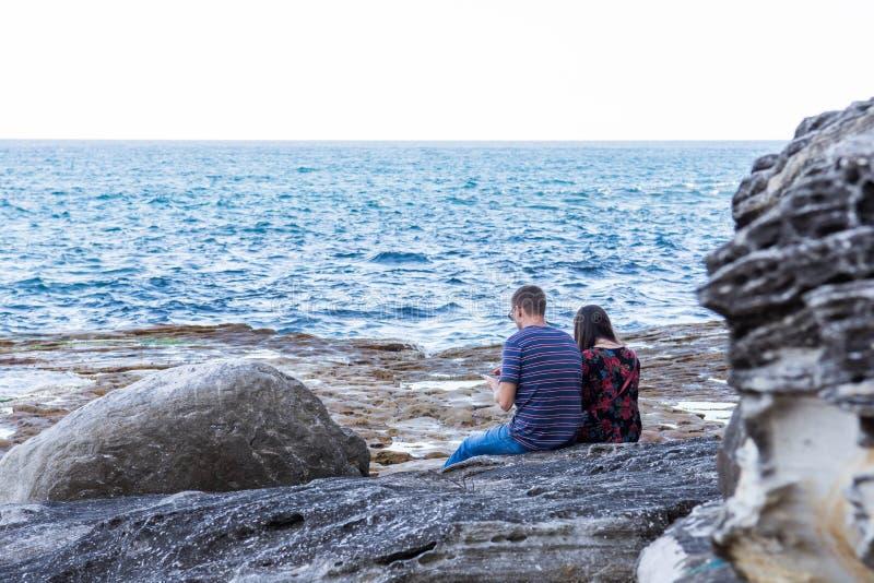 Couple enjoying an open sea side stock photo