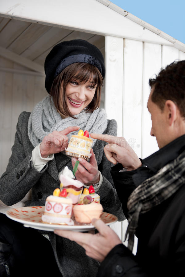 Download Couple Enjoying Pastry Outdoors Stock Photo - Image: 17804834